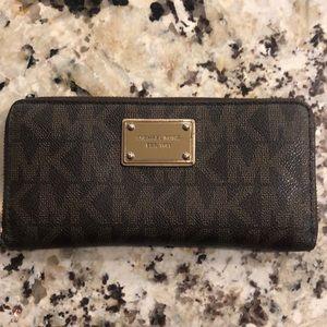 Like new brown Michael Korda wallet